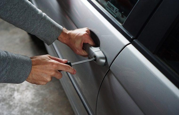 car thief breaking into car